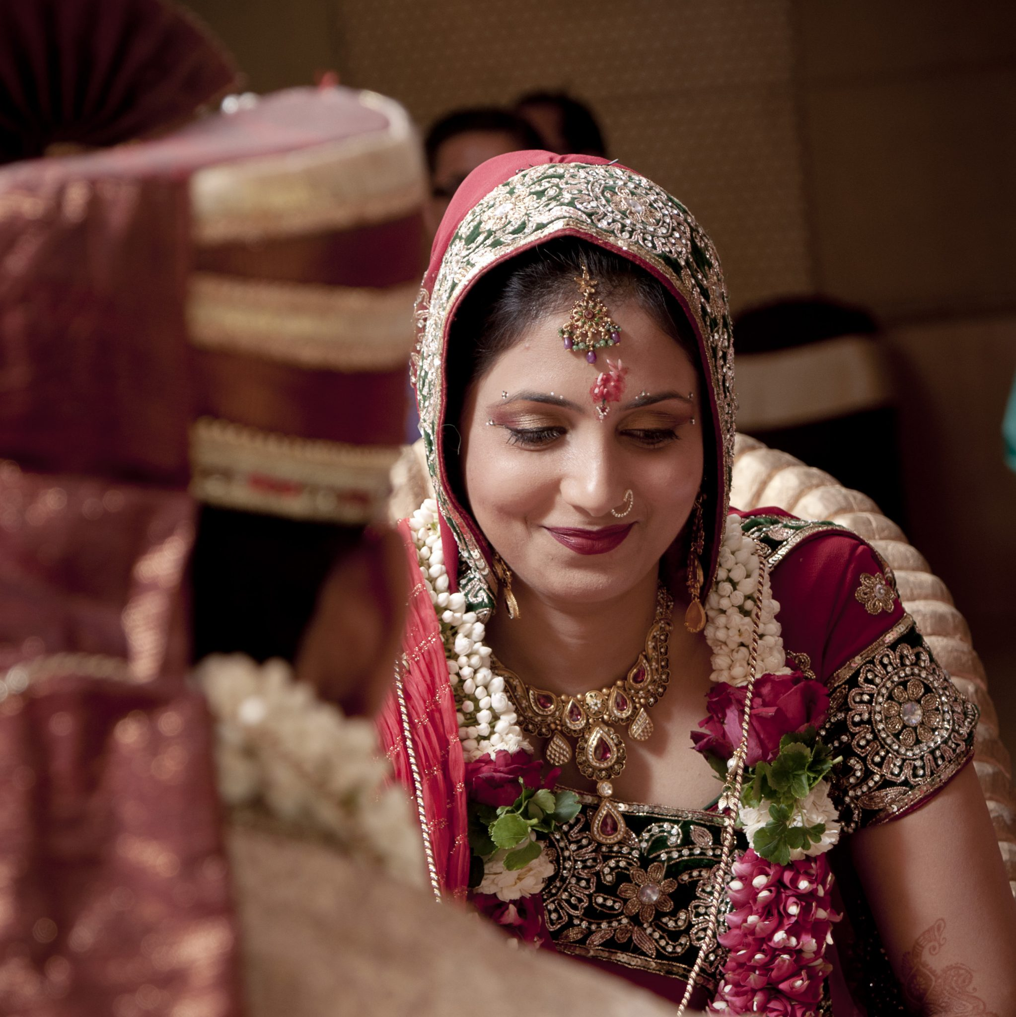 Shy smile of a bride in a Hindu wedding by kunjan detroja