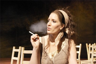 Fiona Harrison vaping or e-smoking on stage of Carmen at a Welsh National Opera production in Swansea, South Wales