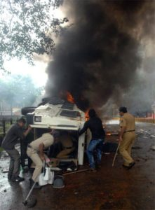 Van set on fire by angry Muslim protesters in Mumbai