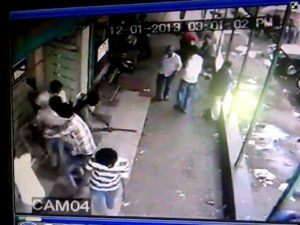 CCTV Screen grab 1 -- unknown assailants crowding in