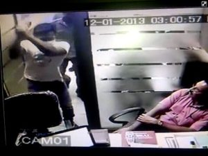CCTV screen grab 5 - unknown man swinging a wooden club at Sulaiman Bhimani