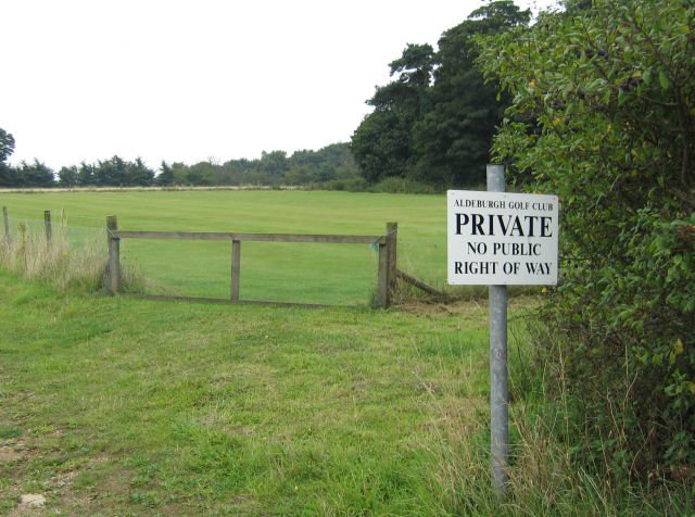 A do not disturb sign at a Gol Course emphasizing private property