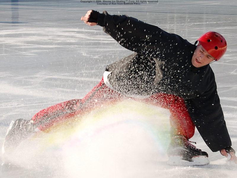 An extreme ice skating move that sprays ice like a rainbow