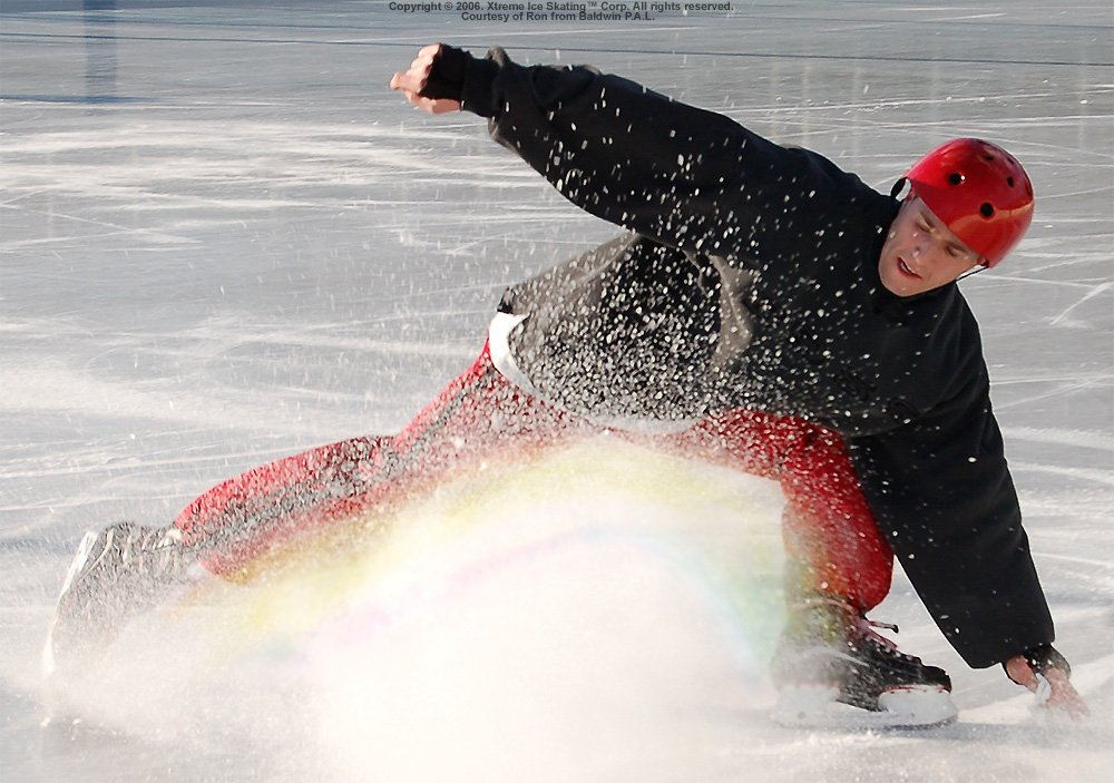 An extreme ice skating move that sprays ice like a rainbow