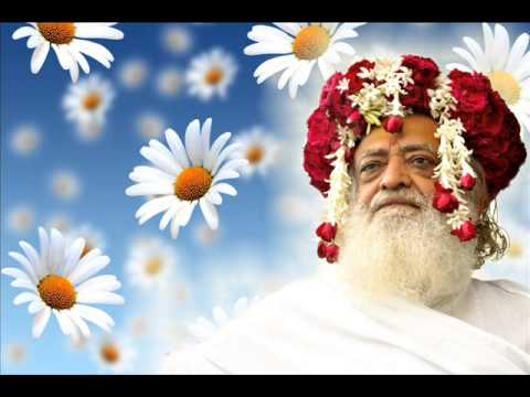 asaram bapu against a blue background and flowers