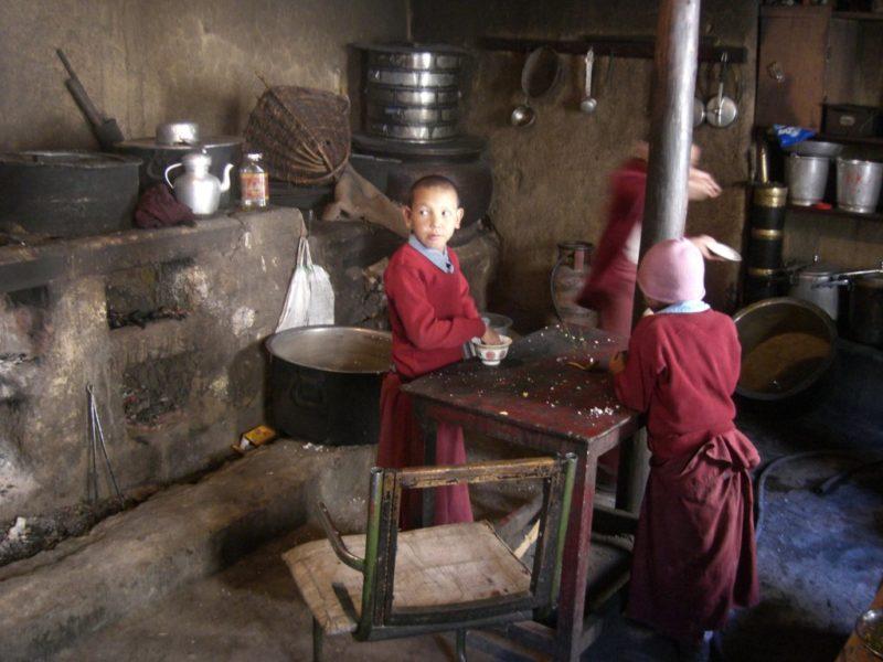 student lamas having a snack in Ki Monastery
