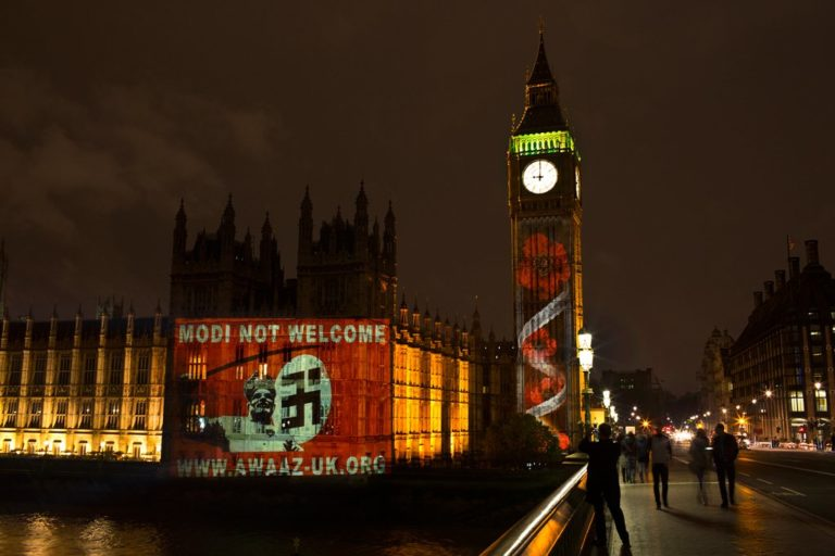 ModiNotWelcome Awaaz Netowrk campaign projected this poster on the UK Parliament
