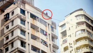 woman attempting suicide from top of building