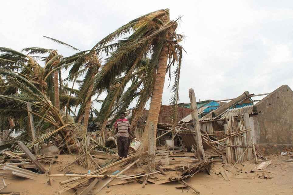 Cyclone Phailin destroyed homes at Arya Palli village. Image: @BengalNewzIndia