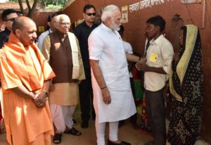 Modi and Adityanath interacting with people at Shahanshahpur varanasi