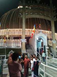 dalits posing in front of Deeksha Bhoomi on Dhamma Chakra Pravartan Din