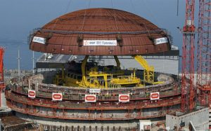 "(FILES) - A photo taken on July 16, 2013 in Flamanville, northwestern France, shows the installation of a dome on a reactor's building on the construction site of the third European generation Pressurised Reactor (EPR). A new ""anomaly"" in the construction of the EPR at Flamanville was detected in the nuclear reactor, the Autorite de Surete Nucleaire (ASN - Nuclear Safety Authority) announced on April 5, 2015. AFP PHOTO / CHARLY TRIBALLEAUCHARLY TRIBALLEAU/AFP/Getty Images"