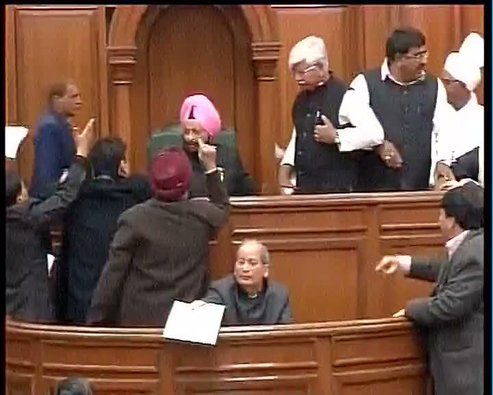 MLAs surrounding speaker in Delhi Assembly