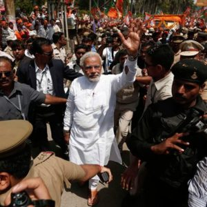 Narendra Modi surrounded by security and fans