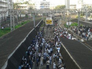 protesters and <strong class='StrictlyAutoTagBold'>police</strong> on railway track at <strong class='StrictlyAutoTagBold'>CST</strong> station