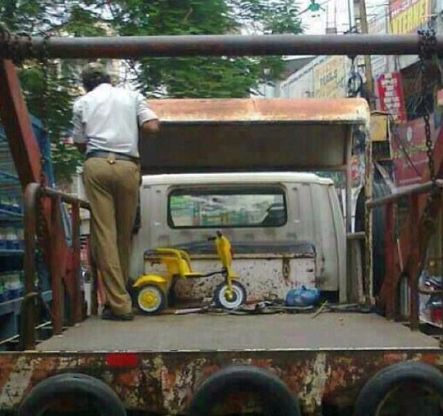 tricyce in the back of a traffic police pick up